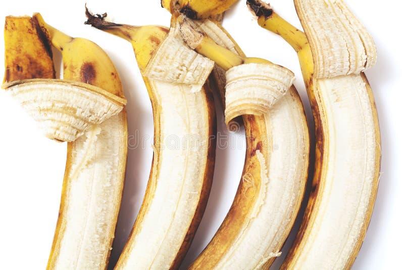 Delvis skalad lögn för banan fyra i horisontalrad royaltyfri fotografi