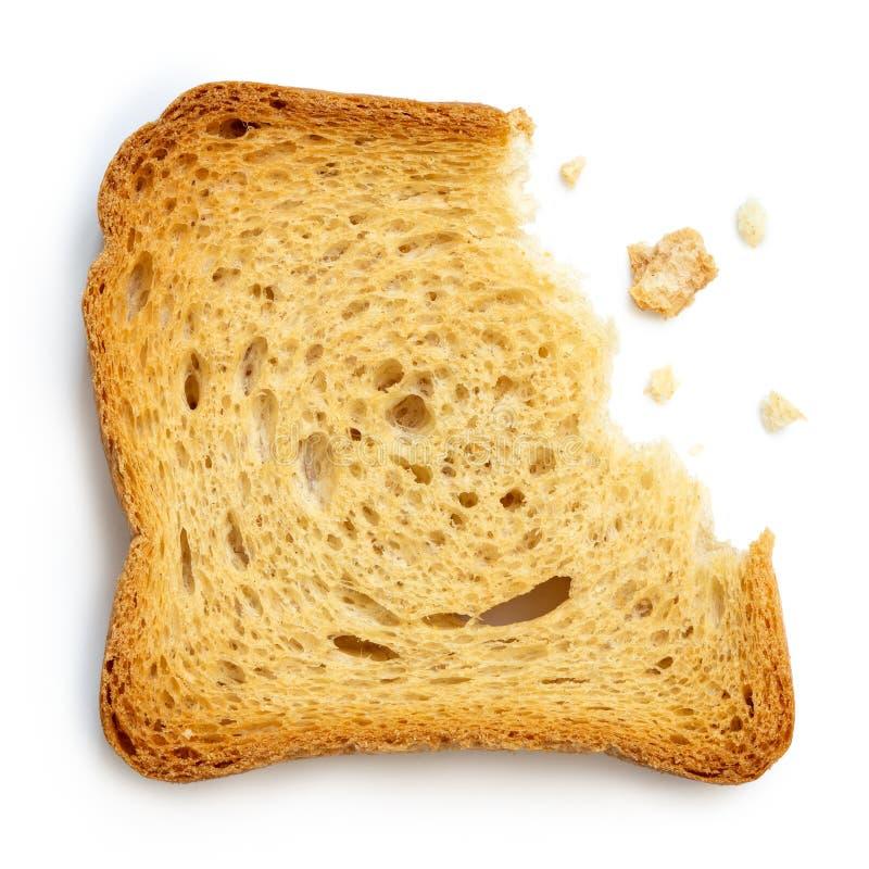 Delvist ätit vanligt melbarostat bröd som isoleras på vit från över arkivfoton