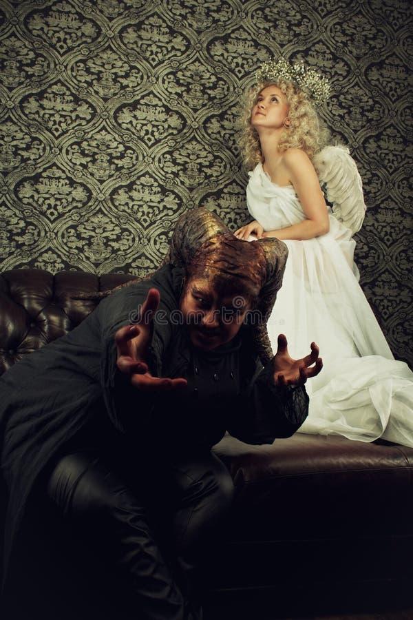 Demônio e anjo imagens de stock royalty free