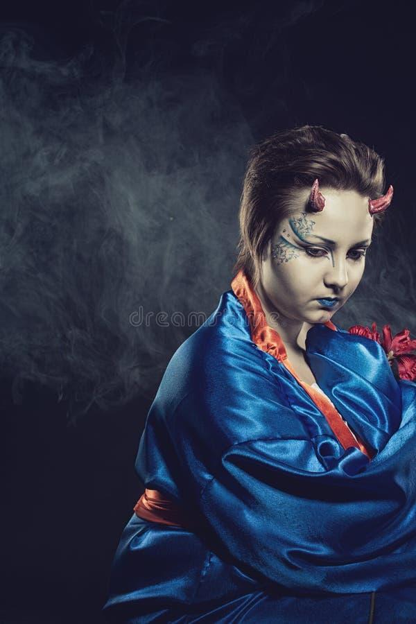 Demônio japonês triste fotografia de stock