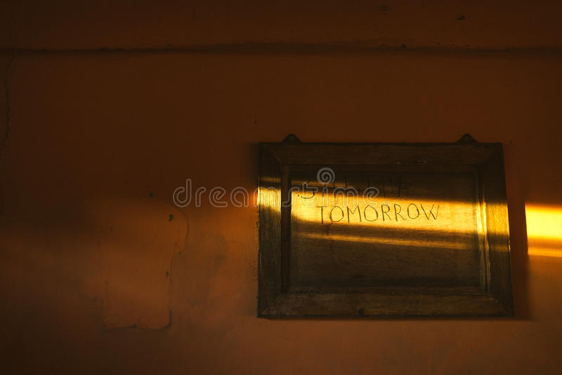 demain L'inscription dans un rayon de soleil photographie stock