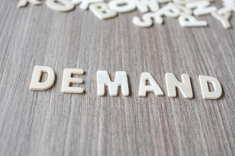 DEMAND word of wooden alphabet letters. Business and Idea. Concept royalty free stock images