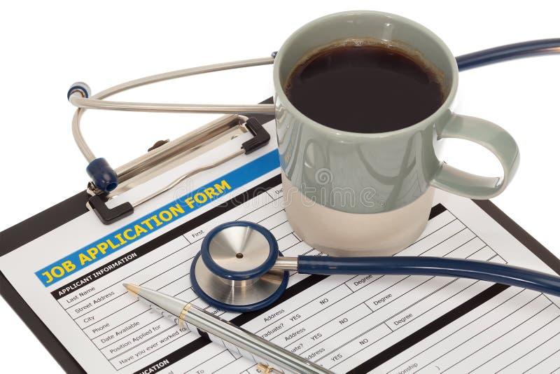 Demande d'emploi avec le stéthoscope photos stock