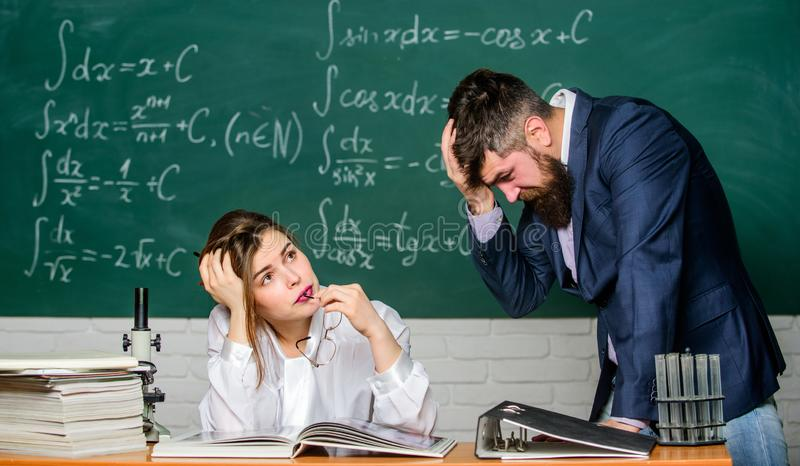 Demanding lecturer. Teacher strict serious bearded man having conflict with student girl. Rebuke and punishment. You. Should make more efforts. Arguing about royalty free stock photos