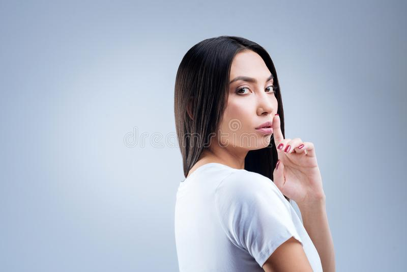 Calm strict librarian asking the visitors to be quiet royalty free stock photos