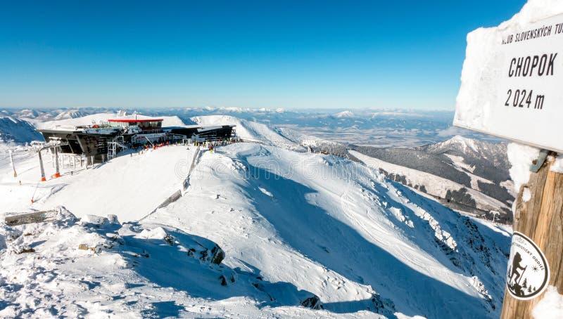 Ski resort Jasna in Low Tatras mountains, Slovakia. DEMANOVSKA DOLINA, SLOVAKIA - JANUARY 22:  Top of the hill Chopok and cableway station in ski resort Jasna stock images