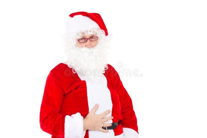 Demasiado comido Santa Claus galletas imagen de archivo libre de regalías