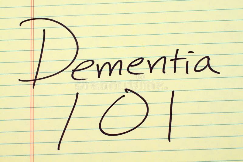 Demencia 101 en un cojín legal amarillo fotografía de archivo libre de regalías