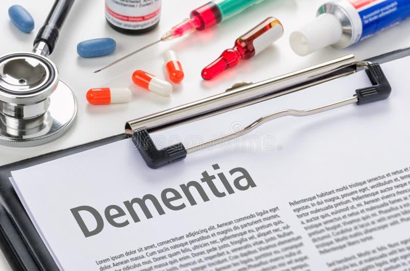 Dementia written on a clipboard. The diagnosis Dementia written on a clipboard royalty free stock photos