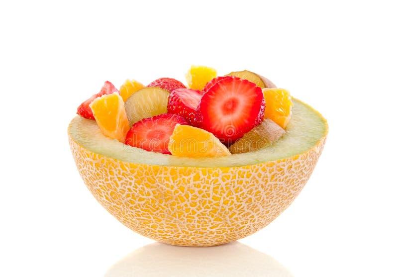 Demi de melon a rempli de fuits images stock