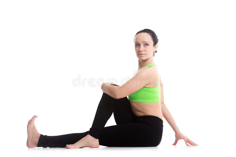 Demi pose spinale de yoga de torsion images libres de droits