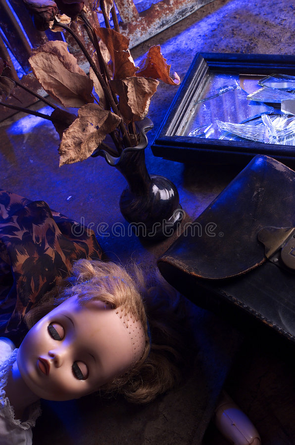 Demise. Doll with horror elements surrounded stock images