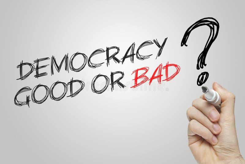 Democracia de la escritura de la mano buena o mala imagen de archivo libre de regalías