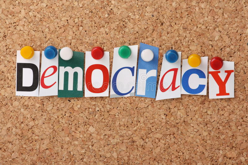 Democracy. The word Democracy in cut out magazine letters pinned to a cork notice board stock images