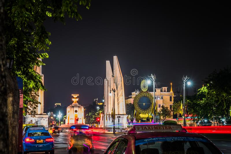The Democracy Monument at night. The Democracy Monument at night is a public monument in the centre of Bangkok, Thailand. It occupies a traffic circle on the stock photo