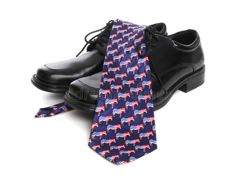 Democrat Business Man Theme. A business man's shoes and a democrat theme tie over white background stock image