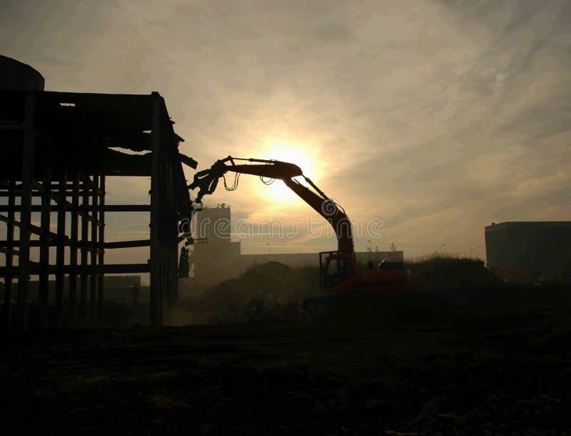 Demolierung-Gräber-Schattenbild lizenzfreie stockfotografie