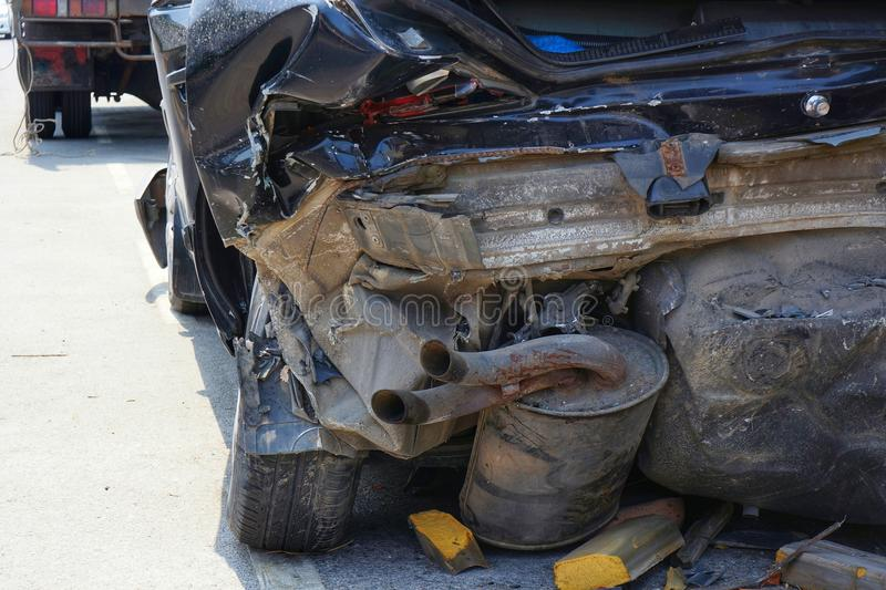 Demolished Rear Part of Dark Car after Accident royalty free stock images