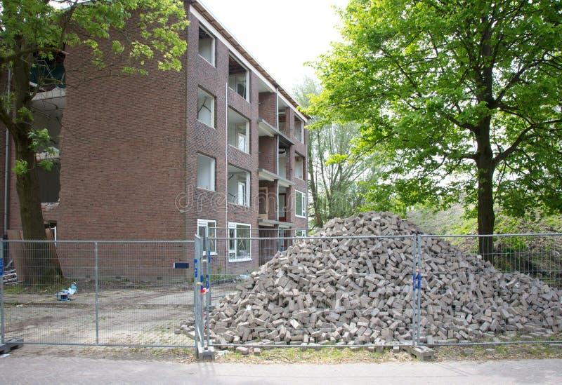 Demolishing a block of flats. Selective focus royalty free stock image