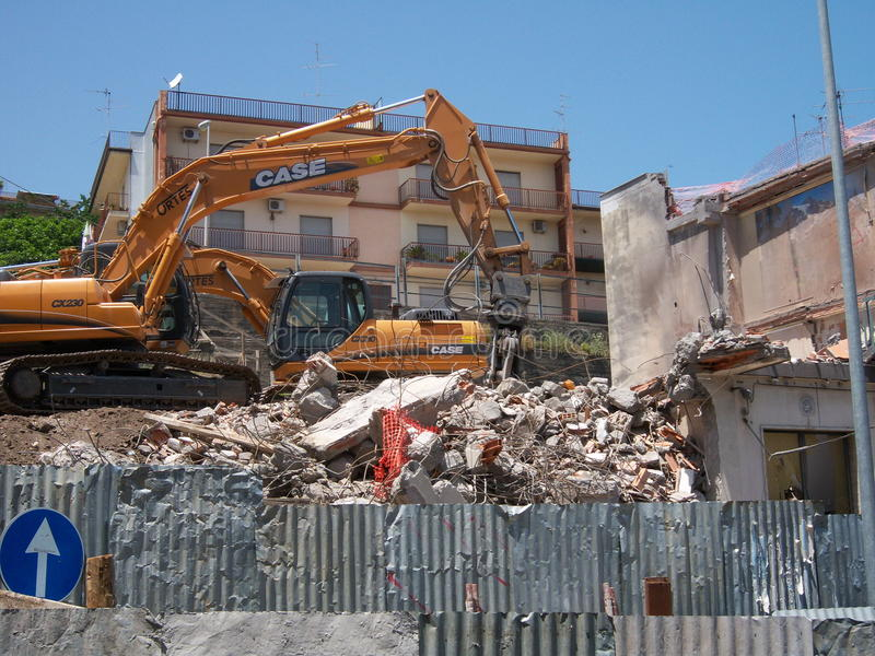 Demolition. Of a seriously damaged building from the 2002 earthquake to Aci Catena (Sicily, Italy). The building has been demolished in 2009 stock photo