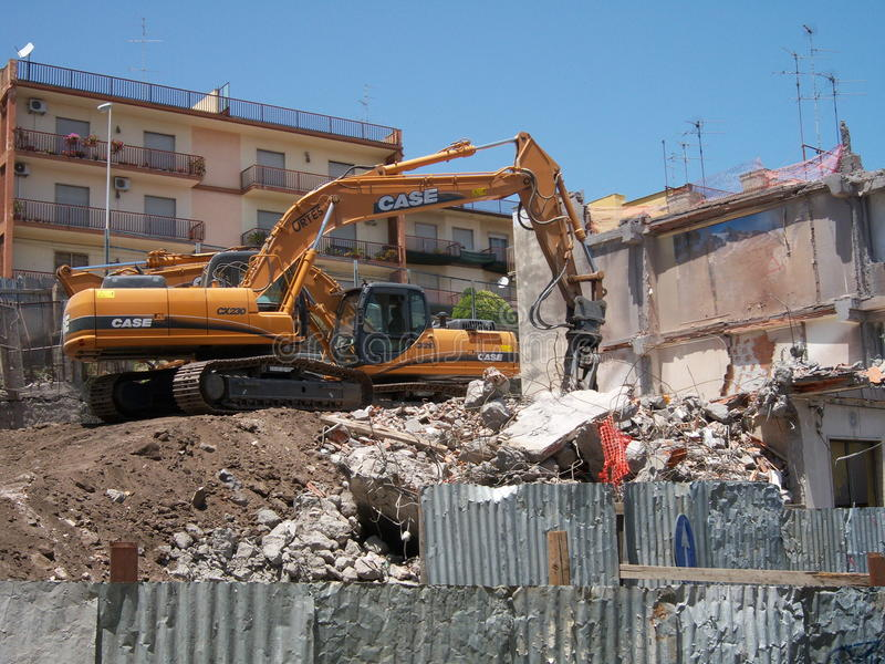 Demolition. Of a seriously damaged building from the 2002 earthquake to Aci Catena (Sicily, Italy). The building has been demolished in 2009 royalty free stock images