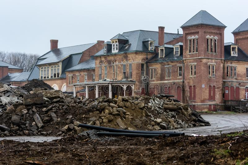Demolition - Abandoned Westboro State Hospital - Westborough, Massachusetts. A gloomy view of the long abandoned Westboro State Hospital in Westborough stock photo