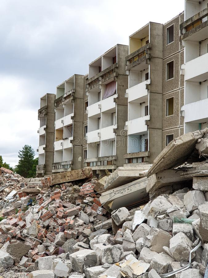 Demolition of a building or house on a construction site. Architecture, damaged, ruins, demolished, destruction, demolishing, industry, block, ancient, wall stock photo