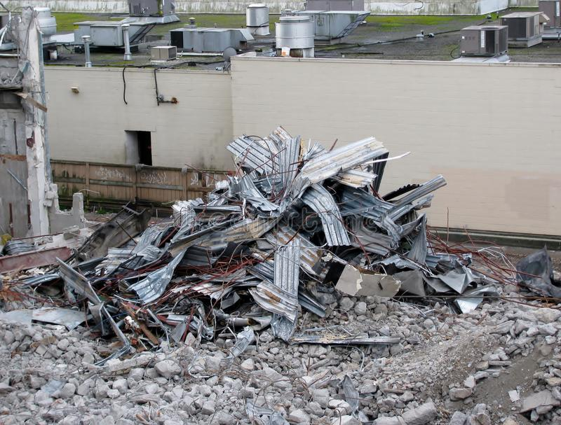Demolition of building in urban environments. New construction site stock photo