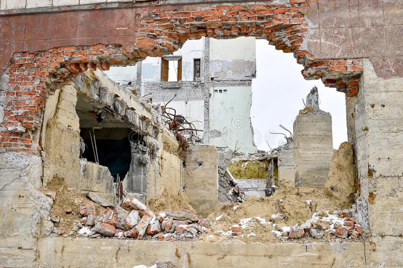 Demolition and dismantling of the remnants of the large industrial enterprise stock image