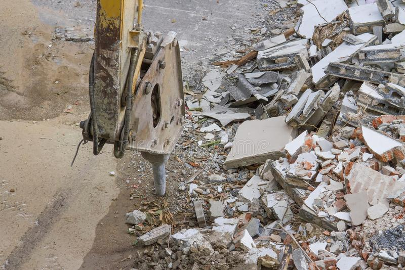 Demolition of an industrial building and drill concrete machine stock image