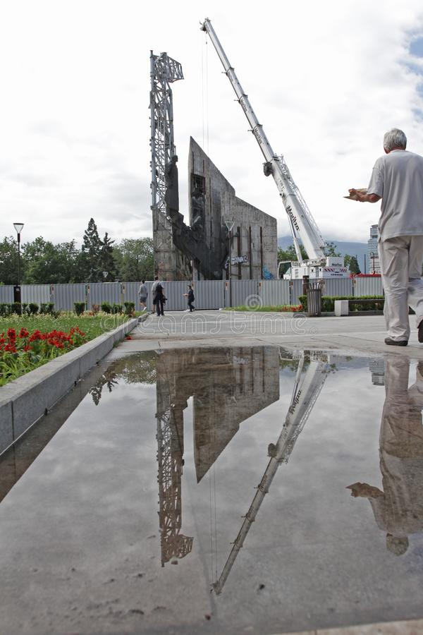 """Demolition of the monument """"1300 years of Bulgaria"""" near by NDK in Sofia, Bulgaria – july 4, 2017. Communist regime. Demolition of the stock images"""