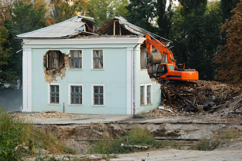 Demolition of an old house stock image