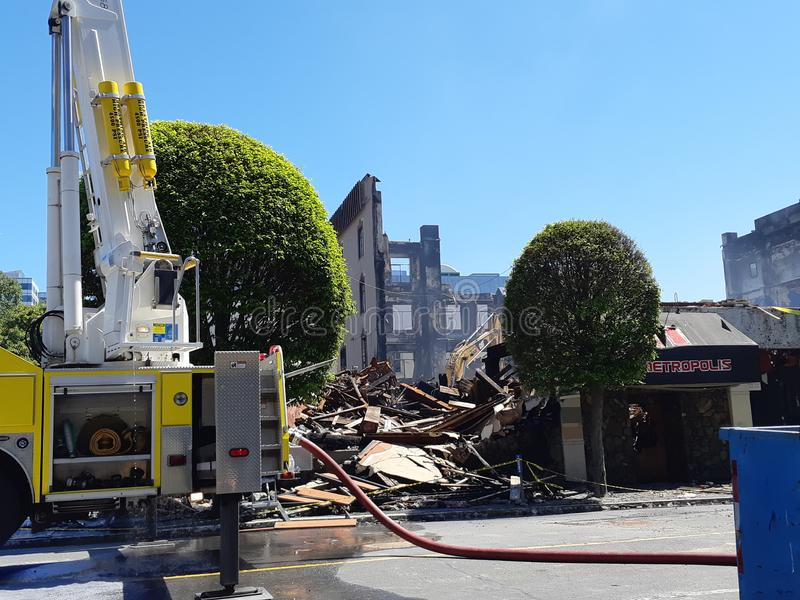 Building demolition after fire. Demolition on the remains of a building ravaged by a fire in Victoria, BC, Canada on May 6, 2019 stock image