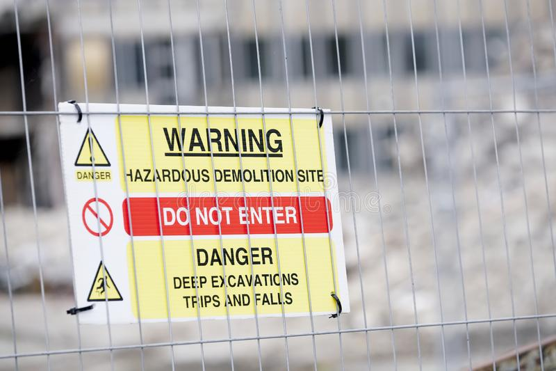 Demolition site building collapse hazard danger sign. Uk royalty free stock photo