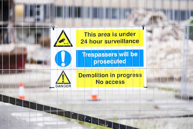 Demolition site building collapse hazard danger sign. Uk stock images