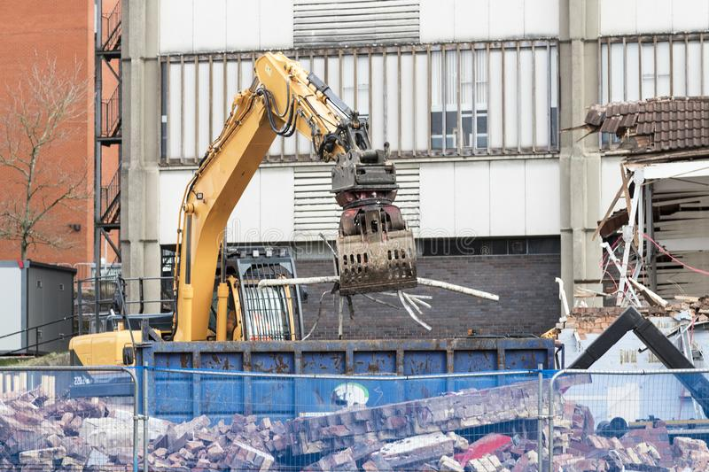 Large yellow grapple machine. Demolition site with large yellow grapple machine stock photography