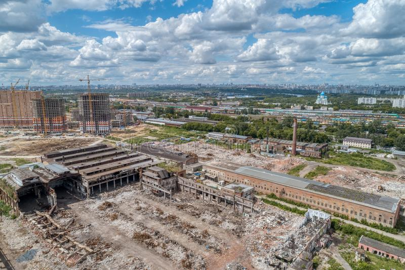 Demolition work of a large old factory. Dismantling on the territory of a big city. aerial view. Demolition work of a large old factory. Dismantling on the royalty free stock photos