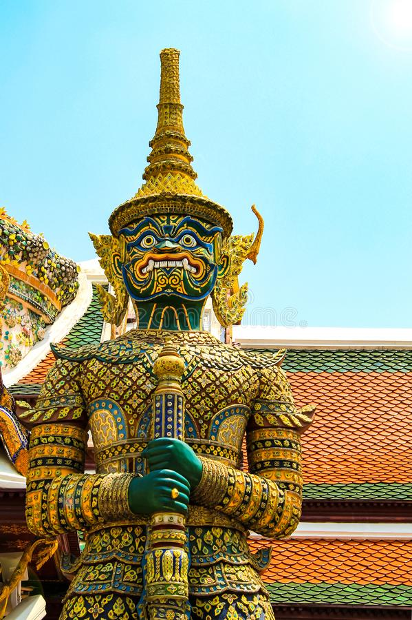 Demon guard at the entrance to the sacred Thai [Temple of the Emerald Buddha, in the capital of Thailand Bangkok. Asia royalty free stock photos