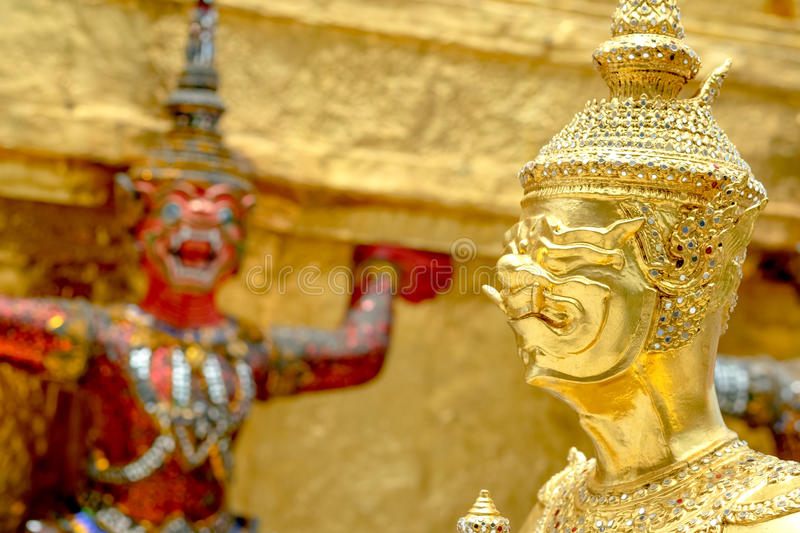 Demon Guardian/ Giant Statues stand around Golden pagoda phra kaew. Golden Demon Guardian/ Giant Statues stand around Golden pagoda phra kaew stock photography