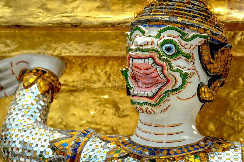 Demon Guardian/ Giant Statues stand around pagoda and hand to li. Ft the base of the golden pagoda of thailand at wat phra kaew royalty free stock image