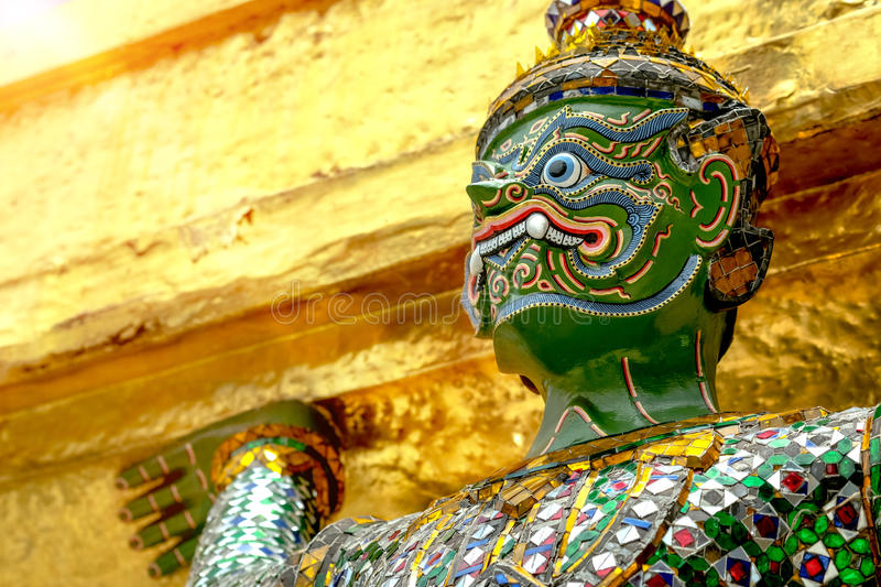 Demon Guardian/ Giant Statues stand around pagoda and hand to li. Ft the base of the golden pagoda of thailand at wat phra kaew stock images