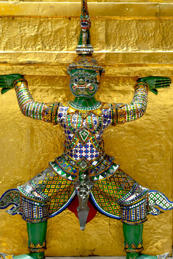 Demon Guardian/ Giant Statues stand around pagoda and hand to li. Ft the base of the golden pagoda of thailand at wat phra kaew royalty free stock photography