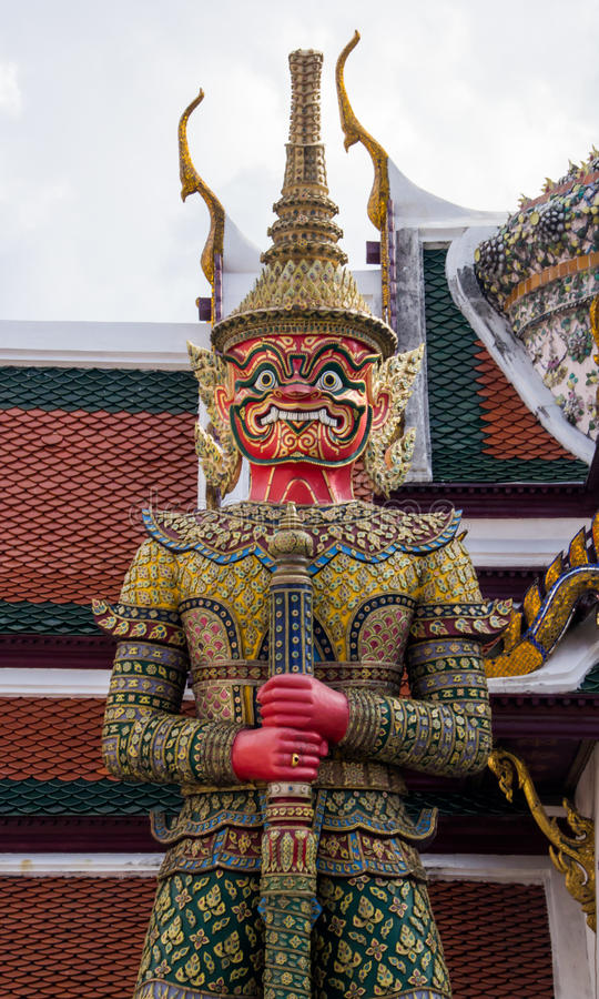 Demon guardian in Wat Phra Kaeo, Bangkok. Wat Phra Kaew is one o. F the most popular tourists destination in Thailand royalty free stock photo