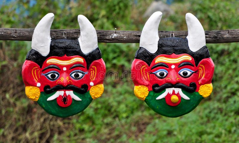 Demon Masks. Two demon masks used to ward of evil in India stock images