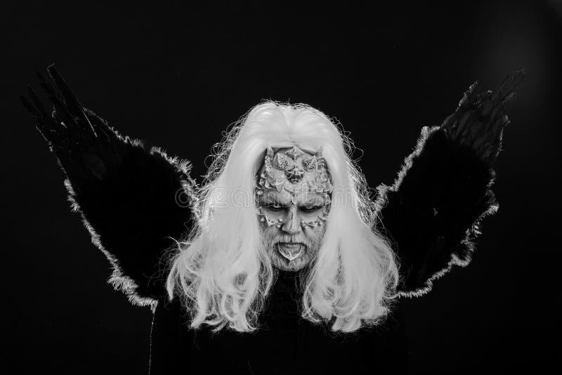 Demon met raaf of kraaiveren royalty-vrije stock foto
