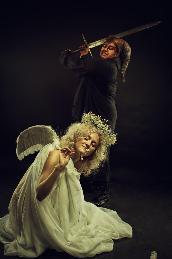 Demon och ängel arkivbilder
