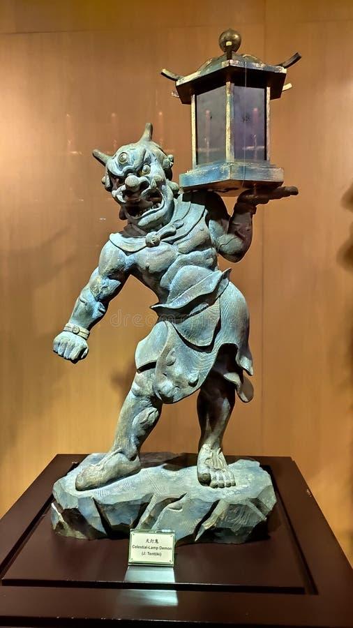 Demonio celestial de la lámpara en el templo de la reliquia del diente de Buda, Singapur foto de archivo
