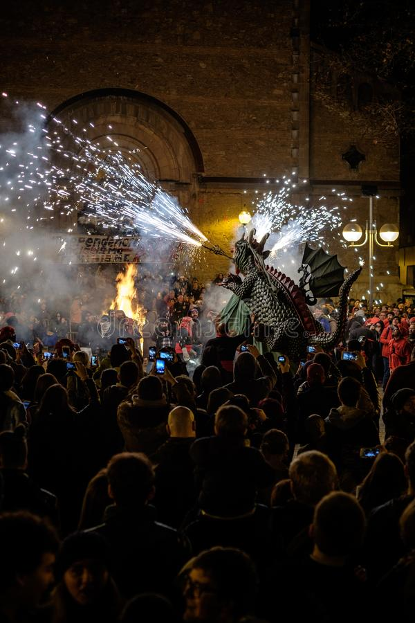 Dragon roar in correfocs. Demons in the traditional holiday of Fouerons, in Barcelona. A group of people dressed as demons go to the streets using fire to scare stock photos