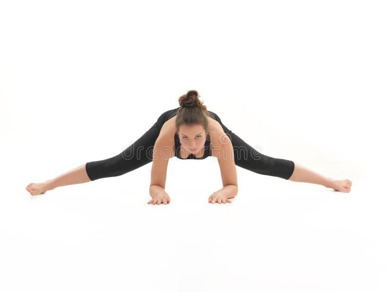 Demonstração de esticar a pose da ioga imagens de stock