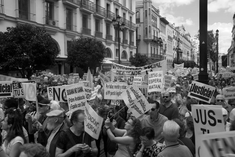 Demonstration in behalf of the Public Health Service 29. This is demonstration in Seville in behalf of the National Health Service and in behalf of a public stock images